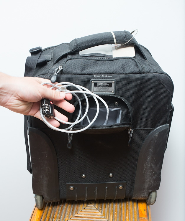 Cable lock in the back pocket to secure bag in media rooms