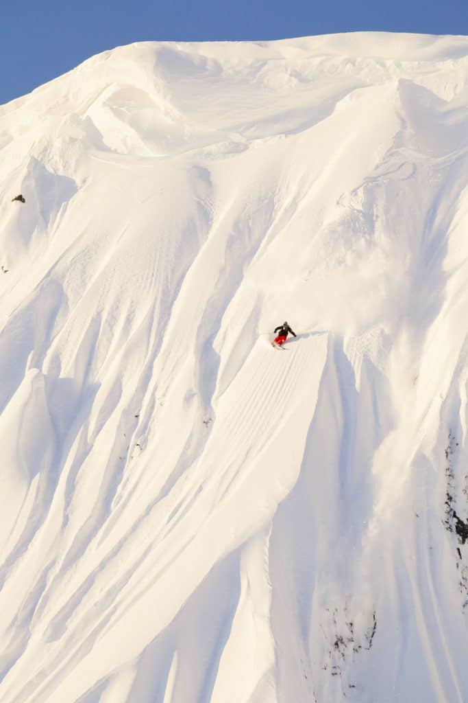 Dane Tudor skis a line at sunrise in Whistler, BC, Canada.
